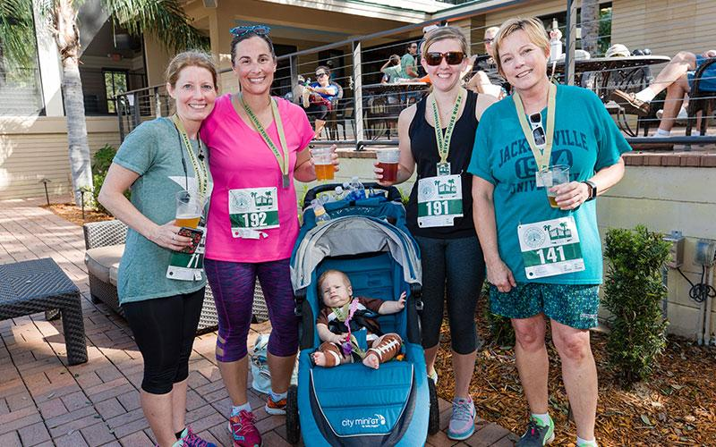 A group of runners celebrating at the River House