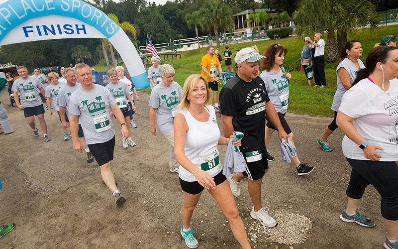 Walkers finishing the River House Run