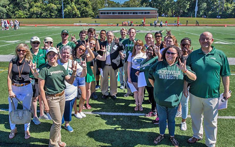Fine Arts Alumni sung the Alma Mater before the Homecoming game
