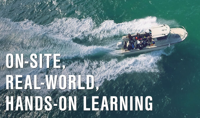 Overhead view of a JU research boat speeding through the water. Learn more about experiential learning.