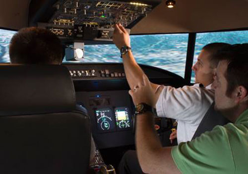 Students in the aviation simulator