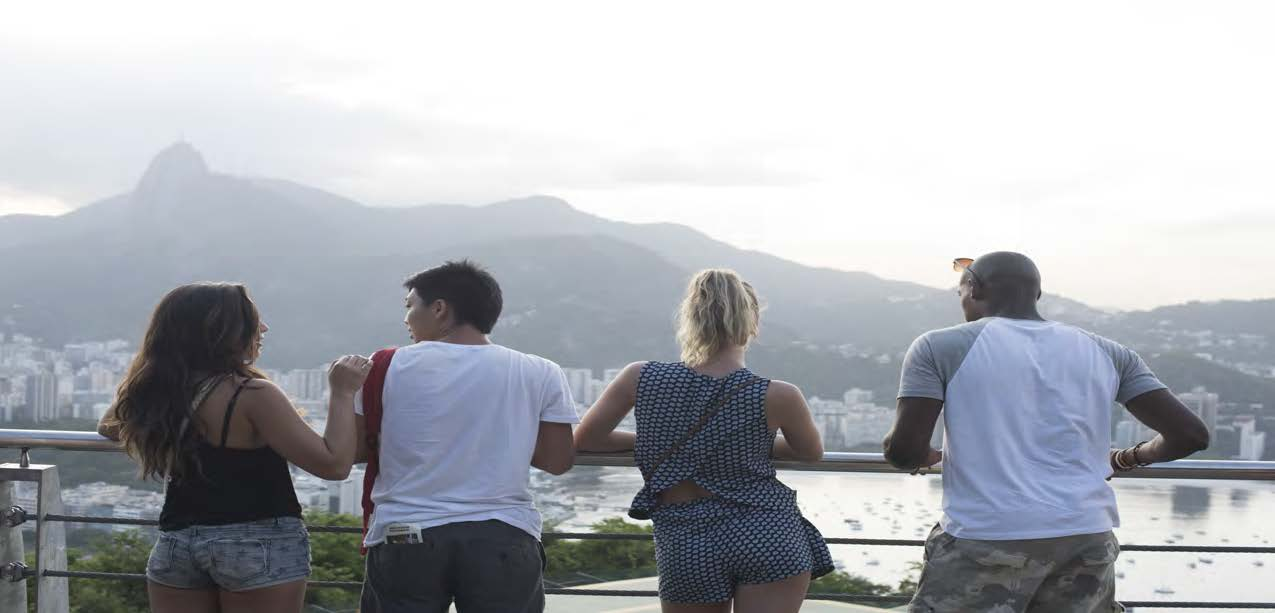 Friends looking over a city on a mountain