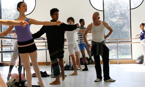 Instructors teaching dance students