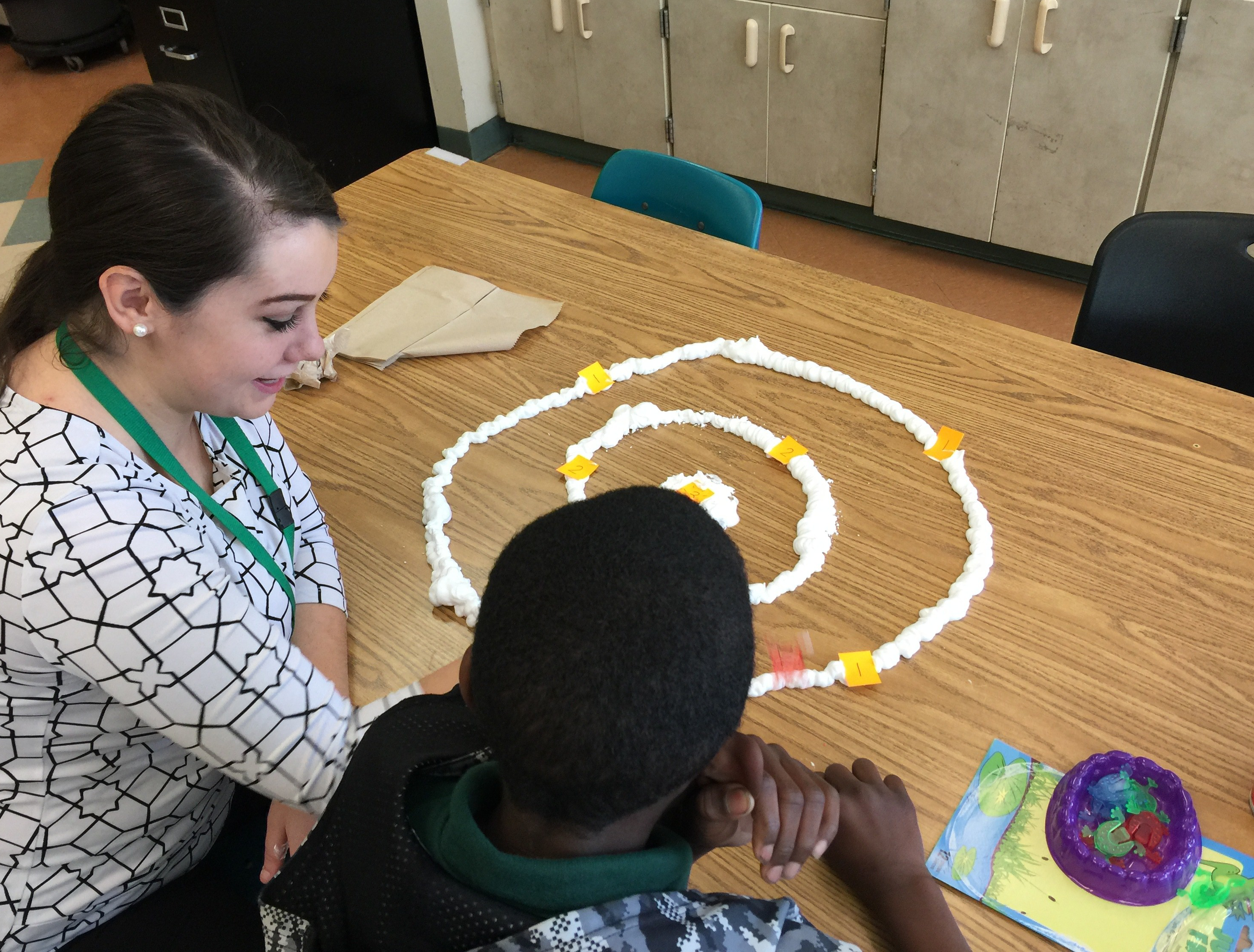 An MS SLP student works with a student at the GRASP Academy​.​​