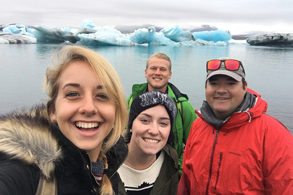 Students posing for a selfie while studying abroad in Iceland.