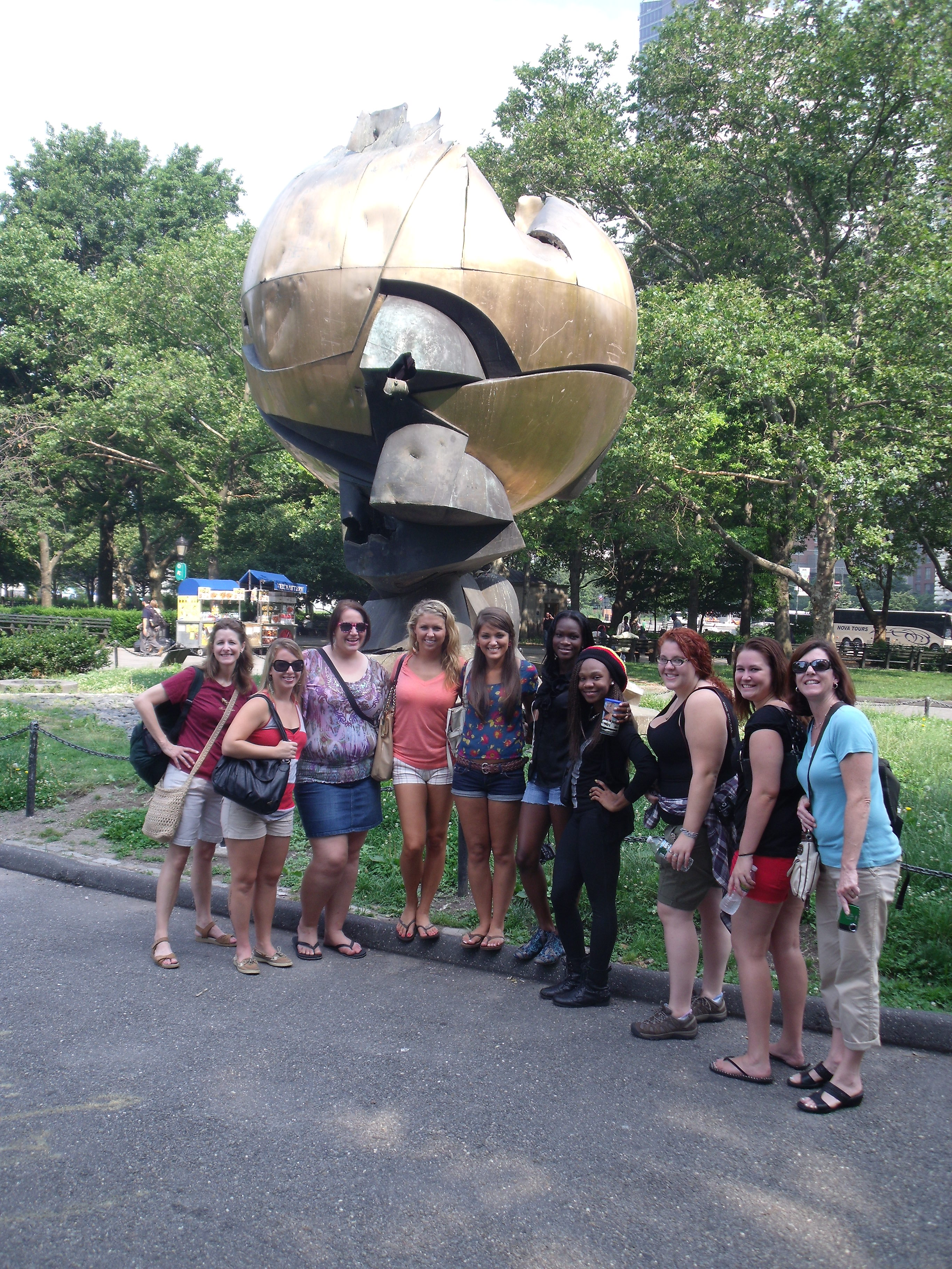 A group shot in front of the 9/11 sculpture.