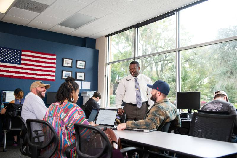 Veteran students learning inside the Defenders Den on campus.