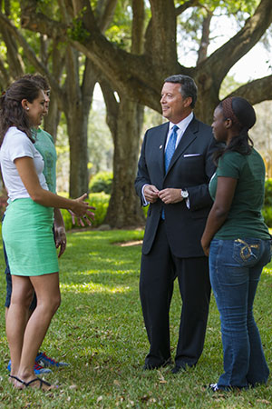 President Cost speaking with students.